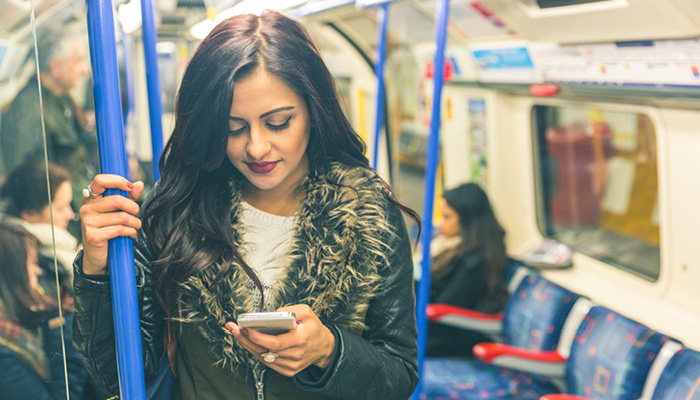 Woman on train looking at phone