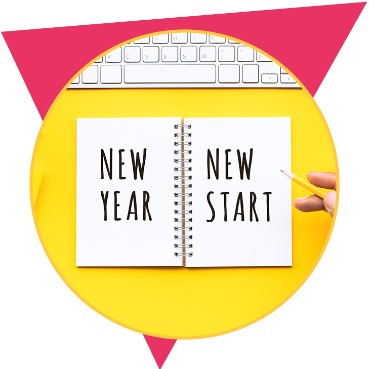 new year, new start journal on yellow desk