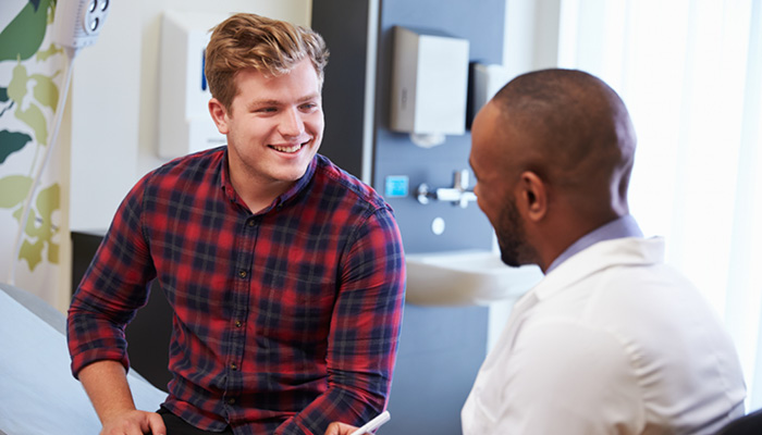 male patient talking with doctor