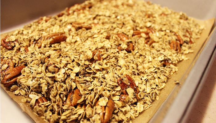 Mixed granola spread on baking sheet
