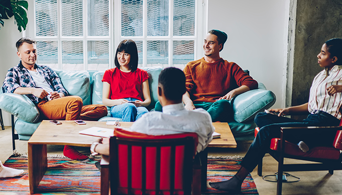 group of friends chatting in living room | when does drinking become a problem