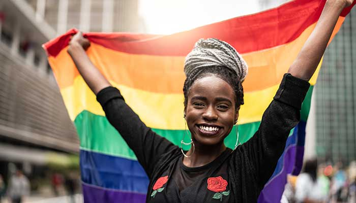 young woman with rainbow pride flag