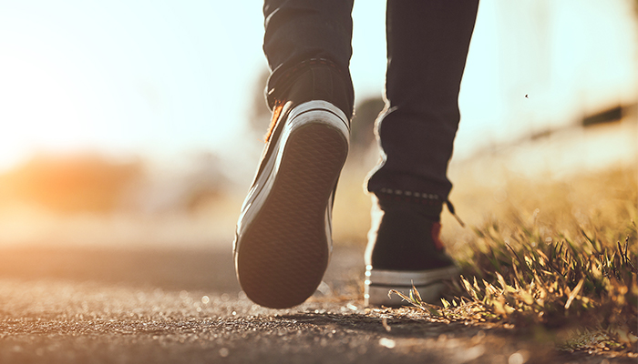closeup of person's sneakers on outdoor walk | tips for managing anxiety
