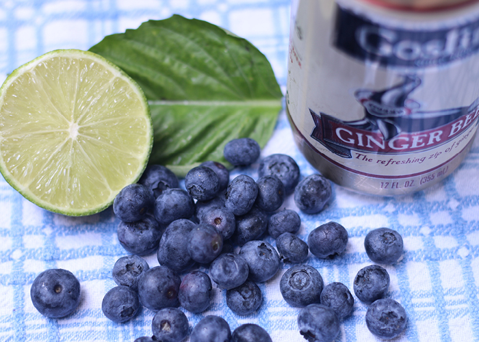 Fresh blueberries, half a lime, basil leaf, and can of ginger beer
