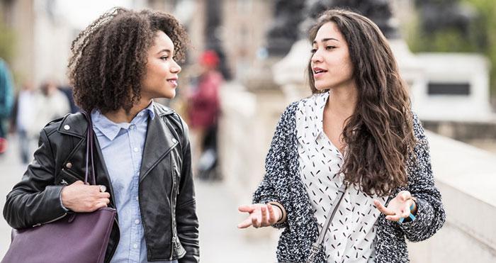 Two girls walking and talking