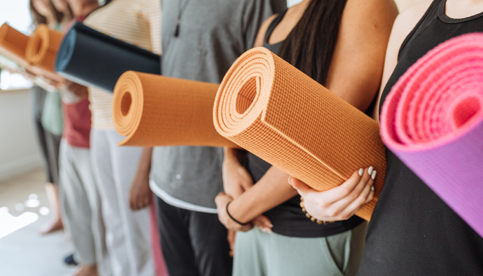 yoga class holding mats