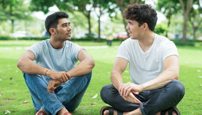 male friends sitting outside talking suicide prevention