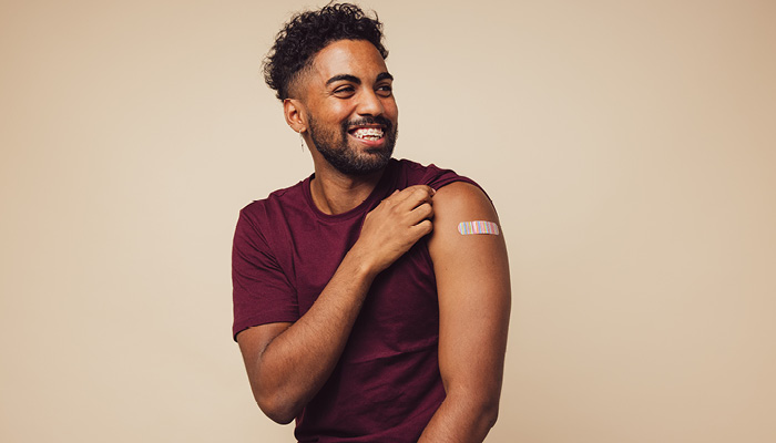 happy and vaccinated Black male | safety of covid vaccine