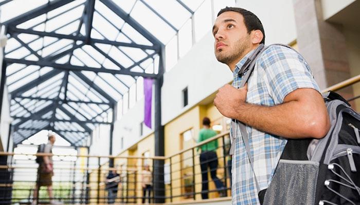 Uncertain boy in college building