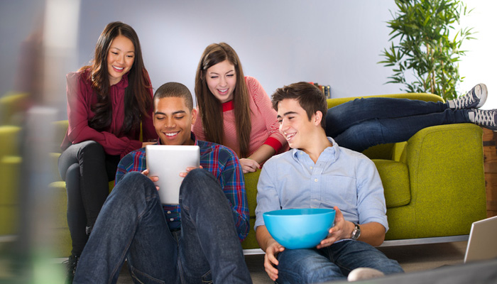 diverse group of friends hanging out at home