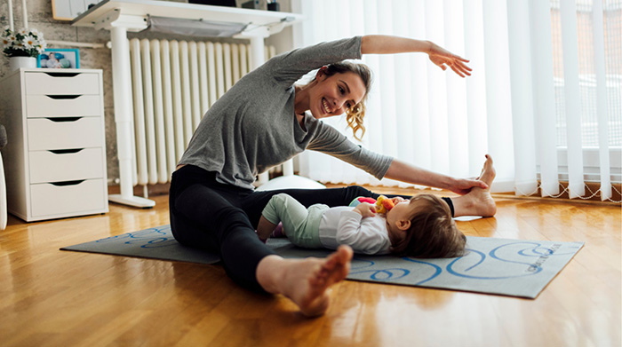 Mom doing yoga with child on floor