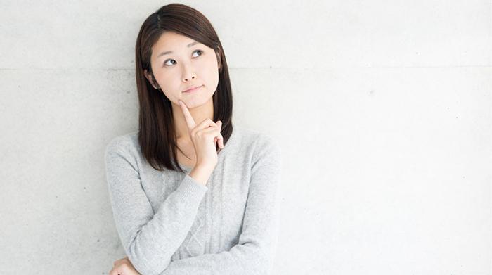Pensive asian female looking upward