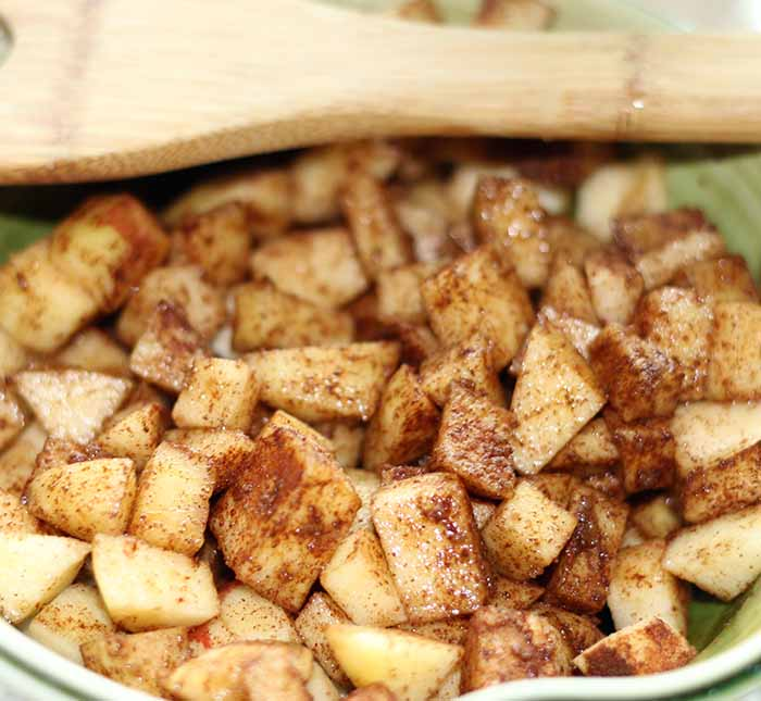 Chopped apples mixed with cinnamon and brown sugar