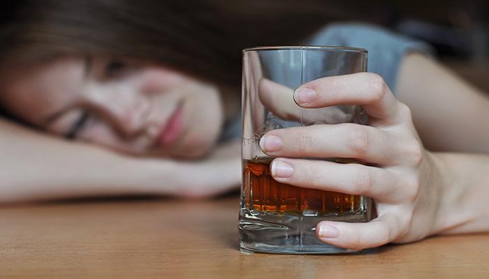 drunk girl asleep with drink