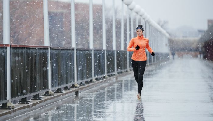 woman running in wet weather