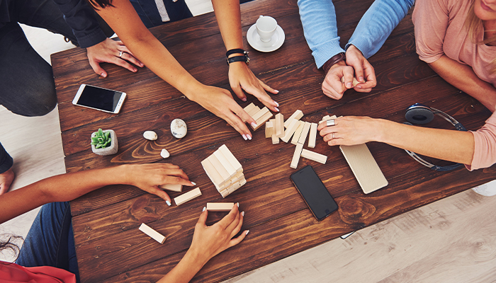 top view of group playing game with blocks   benefits of being sober