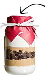 jar filled with cookie ingredients with bow