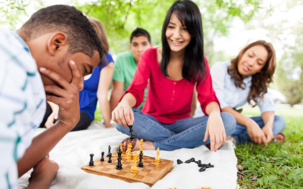Students Outdoors Playing Chess