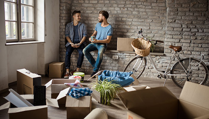 two guys in an apartment with moving boxes