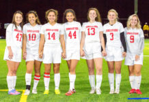 IACS Girls Varsity Soccer Senior class stands together for a picture before their Senior Night game.