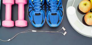 Weights, earphones, running sneakers, fruit, and scale