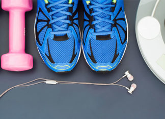 Weights, earphones, running sneakers, fruit, and scale