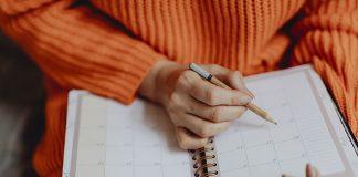 Girl-writing-in-planner