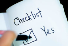 Person-checking-off-an-item-on-a-checklist1