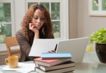 young-black-female-teen-student-studying-for-test-in-dorm