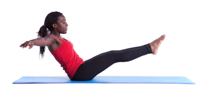 Young woman doing an ab exercise