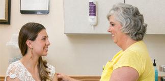 Young woman talking to a nurse before receiving an immunization