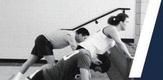 Three college students doing a stair workout