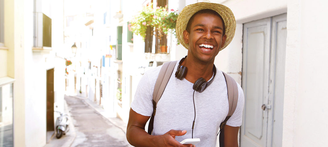 Happy man walking and listening to music