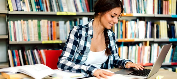 Female-college-student-studying-in-the-library