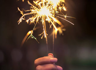 Person holding up a sparkler