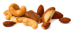 Close-up of mixed nuts isolated on white.