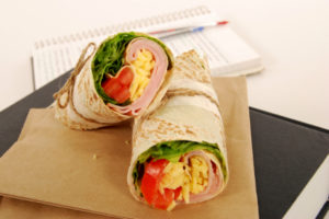 School lunch of ham and cheese wrap sandwich