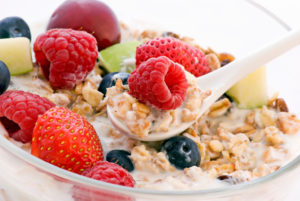 Bowl of oatmeal with mixed fruit