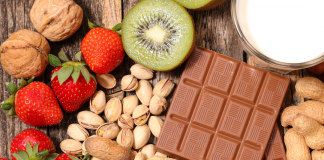 Image of common food allergens: dairy, wheat, nuts, and fruit