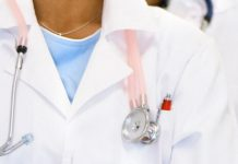female doctor with pink stethoscope