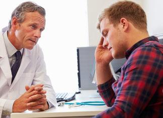 Concerned guy talking to doctor