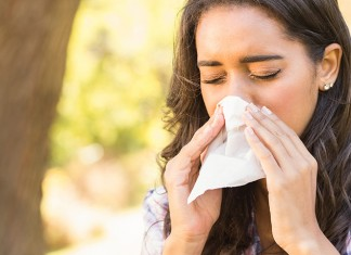 Female blowing nose