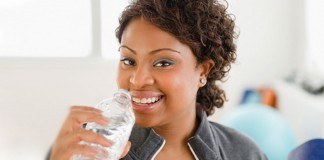 Woman drinking water at the gym
