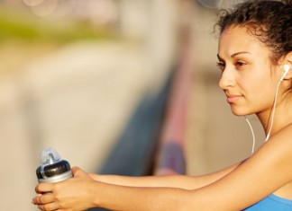 Woman working out holding water bottle