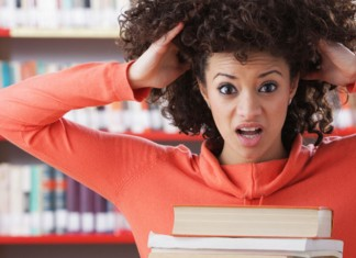 Woman stressing out with books