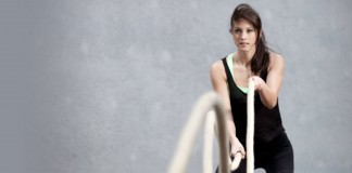 Woman exercising using ropes
