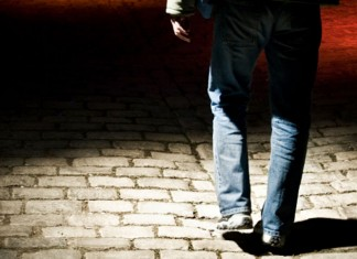 Man walking alone in dark area