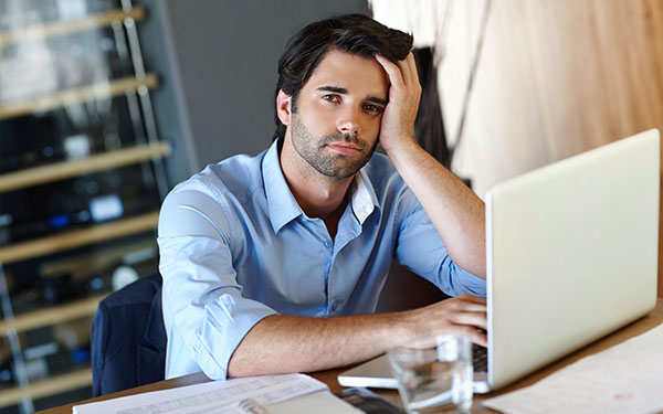 man procrastinating