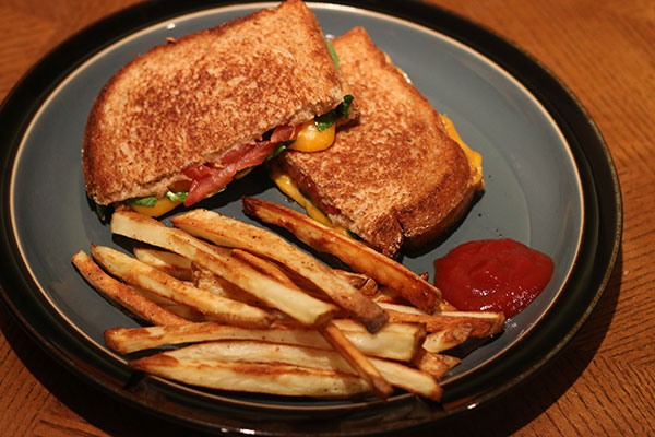 Finished sandwich on plate with french fries