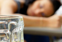 Girl asleep with beer mug
